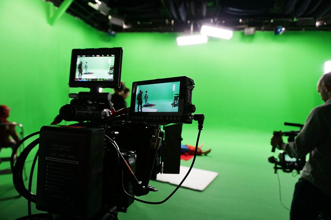 caméra et fond vert pour tournage vidéo